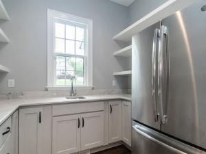 pre-sale custom home side pantry & wet bar